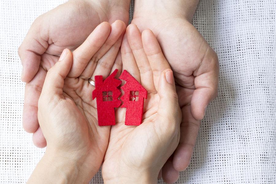 Earthquake Insurance - Hands Holding a Broken Home