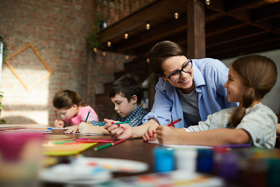 Specialized Business Insurance - Daycare Owner Doing Arts And Crafts With Kids
